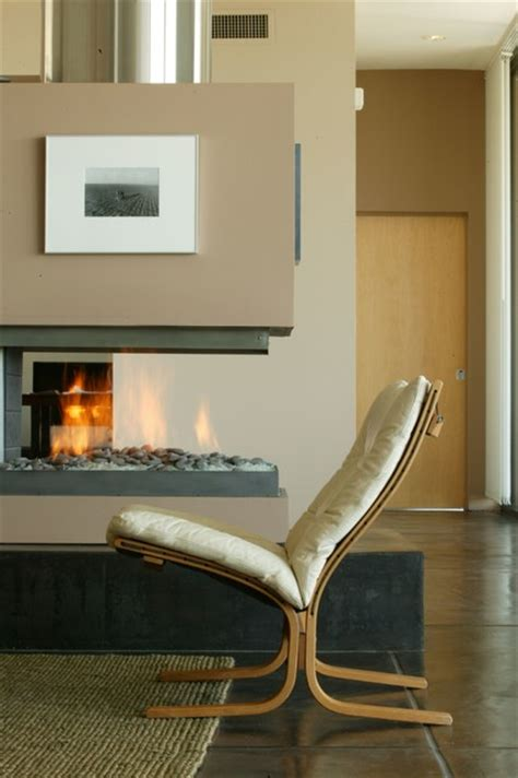 3 way gas fireplace heats the home in winter