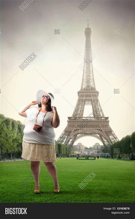 eiffel tower standing l fat woman standing front eiffel image photo bigstock
