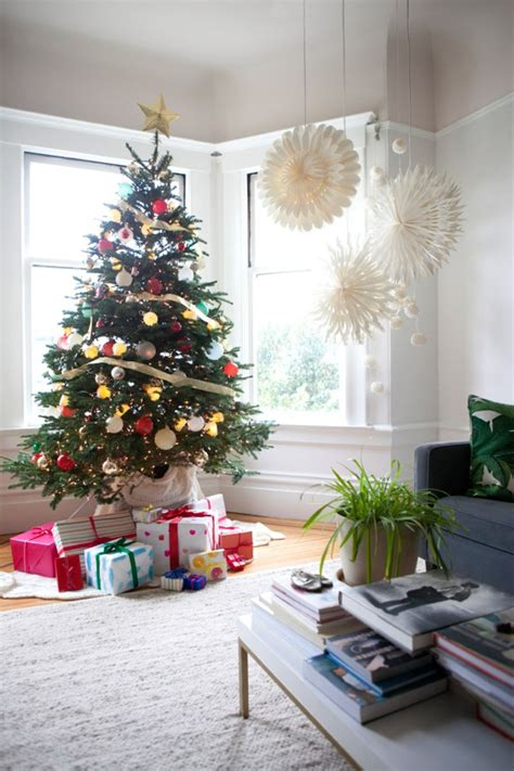festive holiday living room with christmas tree and gift
