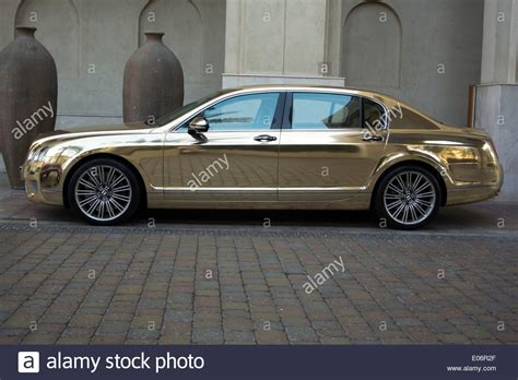 gold bentley gold bentley continental flying spur motor car stock photo