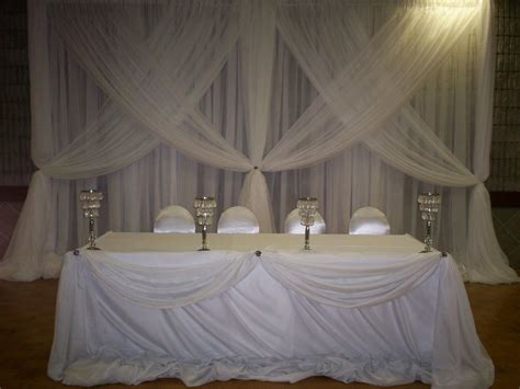 head table draping head table draping with spot lights set the mood decor