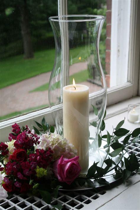 hurricane lamp centerpieces wedding   The window bays were