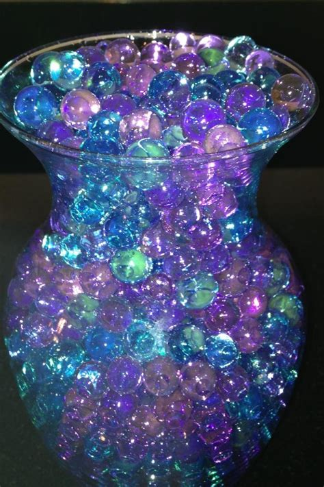 purple and teal wedding centerpieces purple and teal i want some of these so bad the other
