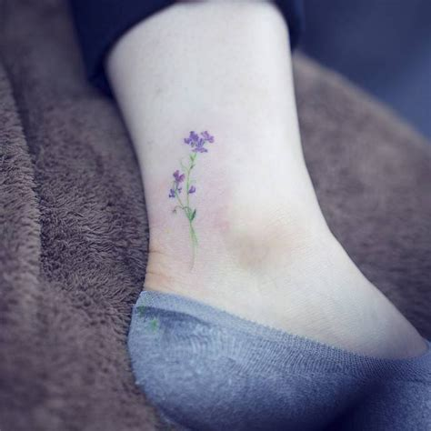 watercolor style sweet pea flower tattoo on the ankle