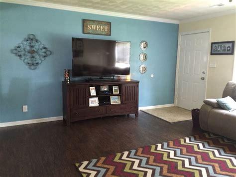 our living room paint color open seas from sherwin williams and decor from homegoods and pier 1