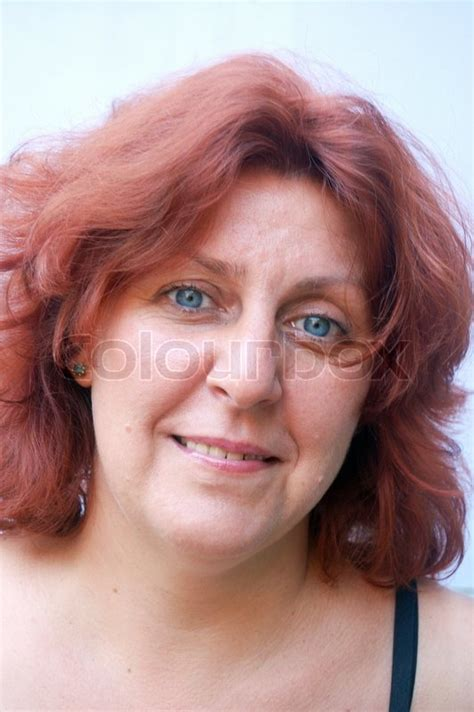 middle age with blue hair portrait of a middle aged blue eyed woman with red hair