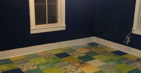 Scrapbook paper floor over wood.   Decoupage ideas