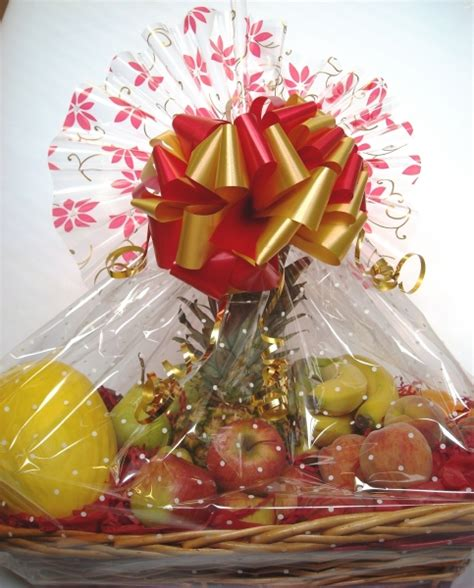 wrapping a gift basket with cellophane document moved