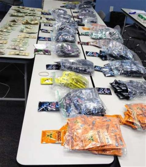 officers find thousands in cash, synthetic marijuana in