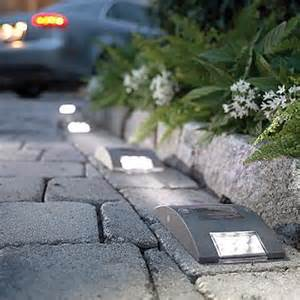 installing solar lights along your driveway padstyle
