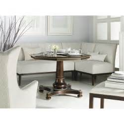 banquette with pedestal table corner in front of window