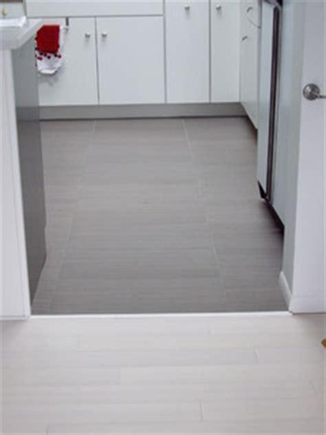 white bamboo floor  linen  gray ceramic tile