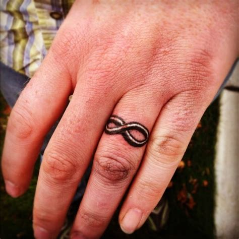 Make A Rocking Couple By Astonishing Ring Tattoos Wedding Ring Tattoos Pics