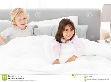 brother and sister in bed happy brother and sister playing in a bed royalty free