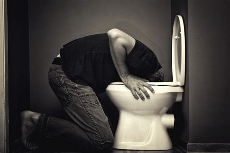 is throwing up vomit can carry norovirus disease particles through the air and remain on surfaces