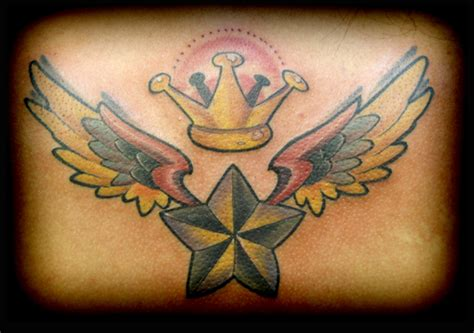 new school crown tattoo star with wings and crown tattoos
