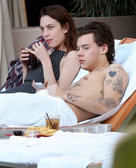harry styles new tattoo of holy bible revealed pictured harry styles new tattoo of holy bible revealed pictured