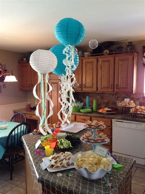 newspaper themed party under the sea mermaid party paper lantern jellyfish