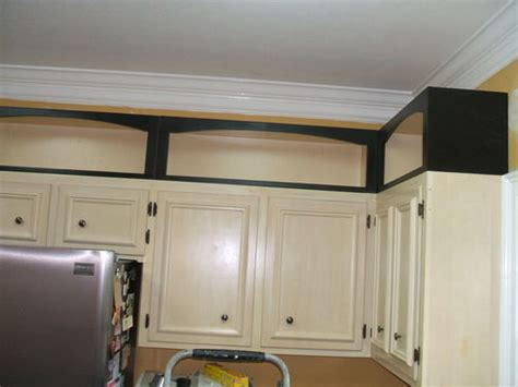 kitchen minor remodel she re trimmed re doored and pimping a kitchen with add on cabinet toppers by david