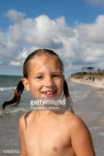 girl laying on beach stock photo getty images portrait of young girl on beach stock photo getty images