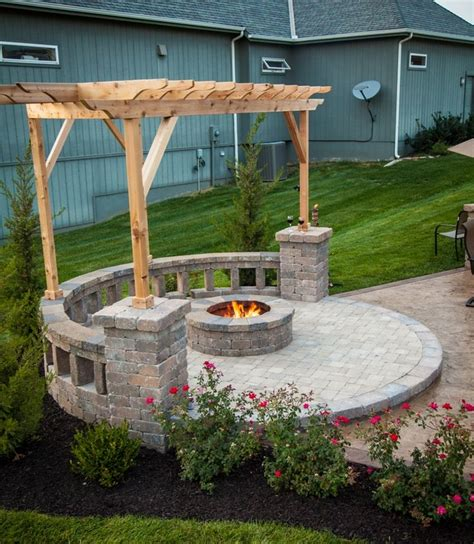 pit with built in seating covered by a pergola