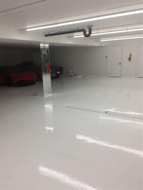 White Epoxy Floor for Exotic Car Garage in Thornhill