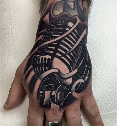 retro microphone hand tattoo best tattoo design ideas