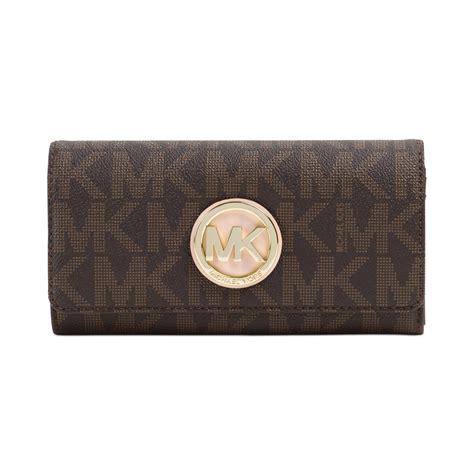 Michael Kors Fulton Wallet michael kors michael fulton carryall wallet in brown brown logo lyst