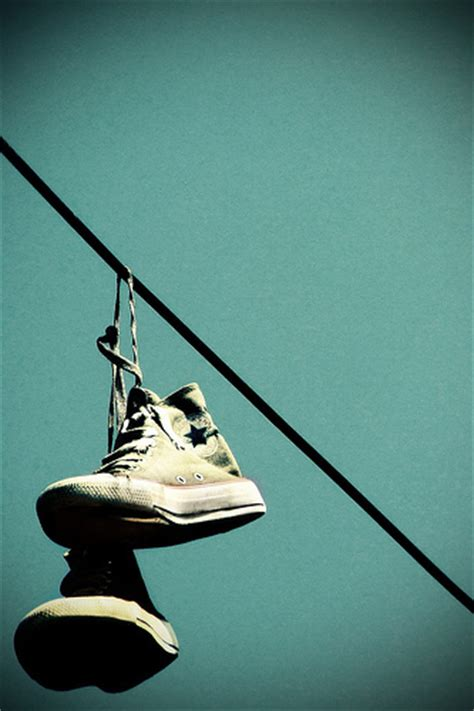 hanging photos on wire chucks hanging from telephone wires converse photo