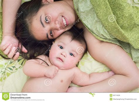 mom son couch children playing hide and seek stock photos male models