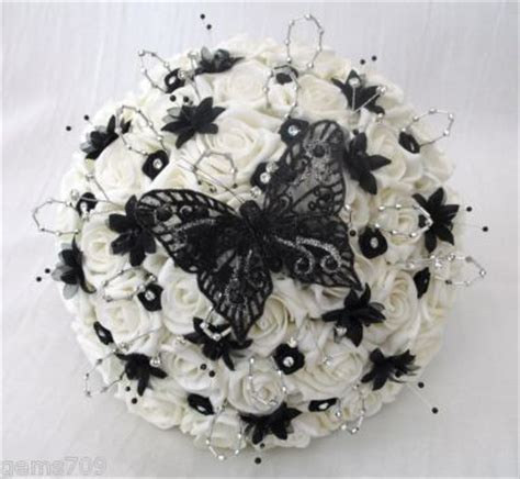 wedding flowers posy bouquet in ivory black silver with diamantes and butterflies