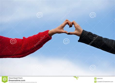 heart shape man scaping heart shape being made by human hands together stock image