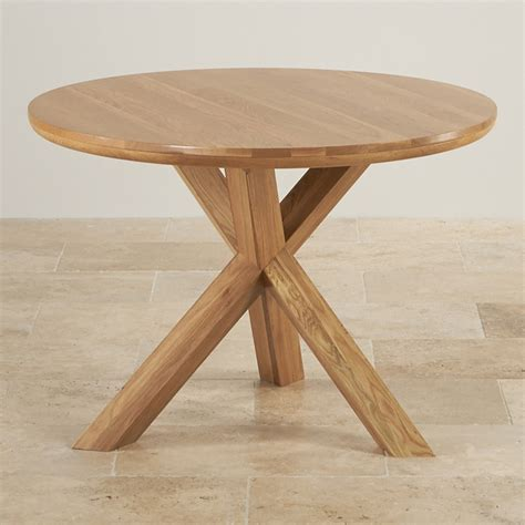 solid oak round table trinity natural solid oak round table with crossed legs