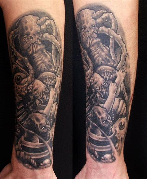 tattoo arm lower biomechanical skulls tattoo on lower arm tattooshunt com