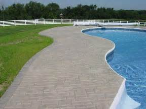 Stamped Concrete Patio With Fire Pit by Decoratively Stamped Concrete Walkway Around Pool