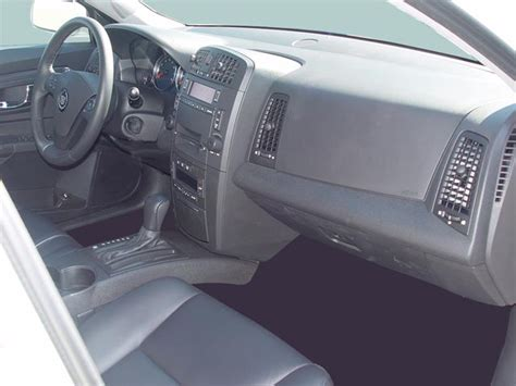 automotive air conditioning repair 2007 cadillac cts interior lighting 2005 bmw 330i 2005 cadillac cts and 2005 infiniti g35 review road test automobile magazine