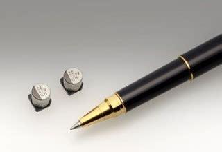 low leakage surface mount capacitor ucv series surface mount electrolytic capacitor with low impedance