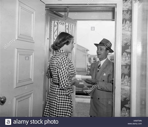 1950s answering door to in business suit