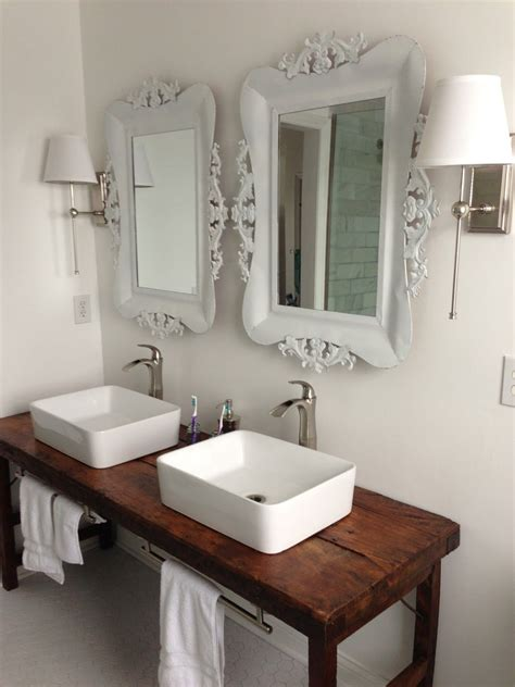 White Bathroom Table white bathroom with vessel sinks and wood table as vanity