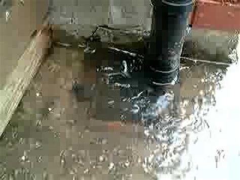blocked waste pipe bathroom drain overflowing with sewage welsh water dwr cymru