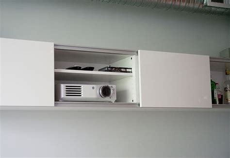 install shelving into wall to store projector and when not
