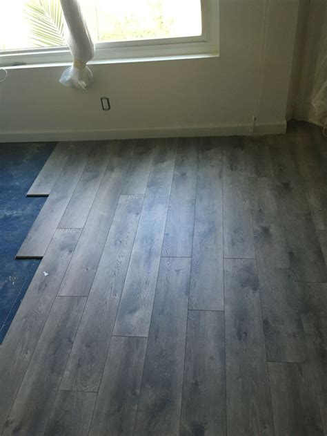 25 best ideas about grey laminate flooring on