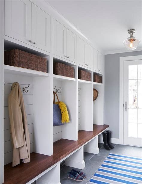 shiplap over concrete mudroom lockers with shiplap backsplash transitional