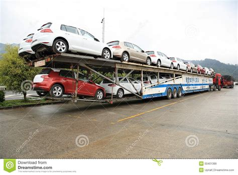 truck car big rig semi truck car hauler with new cars editorial