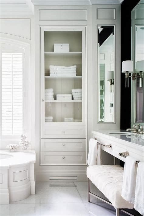 built in cabinets bathroom wainscoted tub with glass door inset linen cabinet