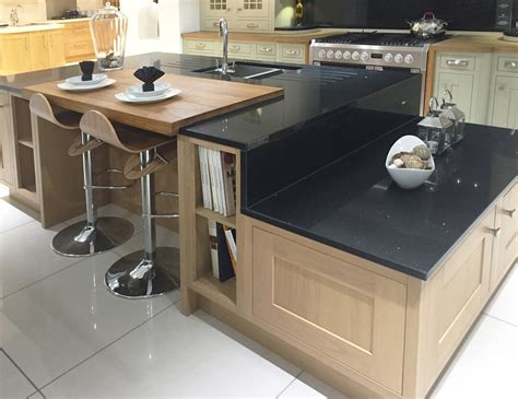 split level kitchen island contemporary kitchen island design in lissa oak with split level granite worktops and breakfast