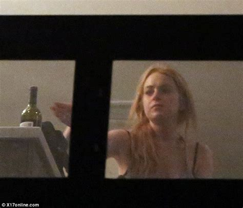 Lindsay Lohan Is Far From Sober by Lindsay Lohan Denies Reaching For Bottle Of Wine But