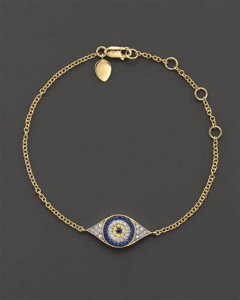 meira t sapphire and 14k yellow gold evil eye