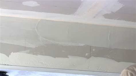 Ceiling Compound by Homeowner Puts Joint Compound Seam Of Drywall Between Wall And Ceiling Stock Footage