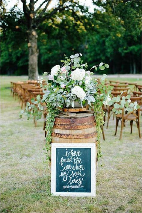 rustic whiskey barrel backyard wedding aisle decor   Deer